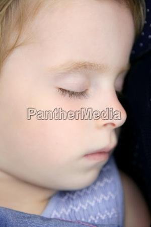 closeup portrait of little blond child