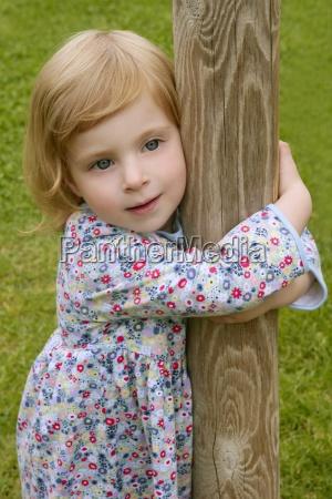 beautiful little toddler girl hug a