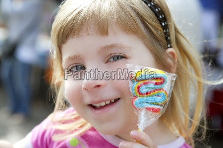 smiling little girl with lollipop sweet