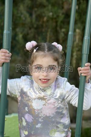 beautiful caucasian little girl with asian