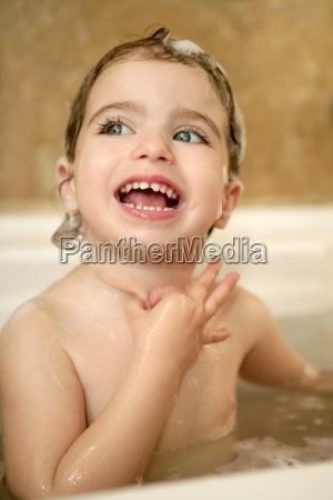 baby little girl having bath on