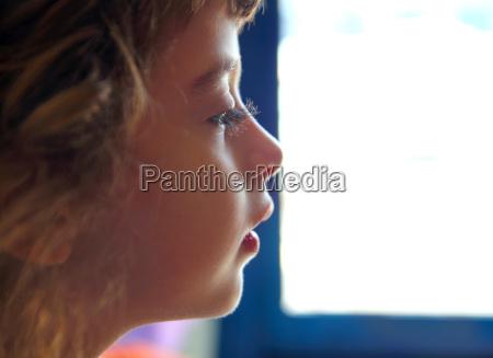 child girl profile portrait in white