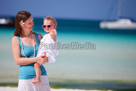 mother and daughter portrait at beach