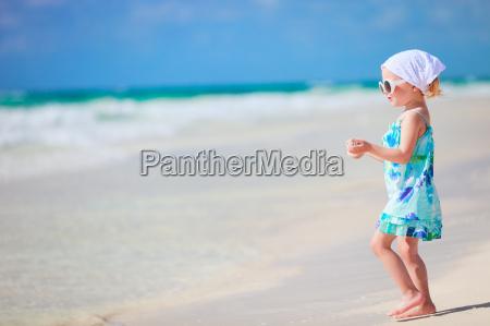 little playful girl at beach