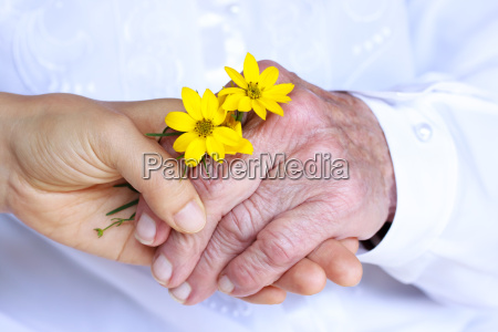 senior young women holding hands
