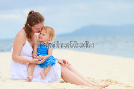 mother and baby together at beach