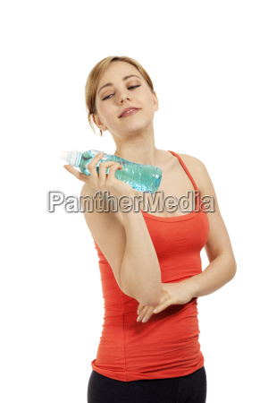 young sporty woman with a bottle