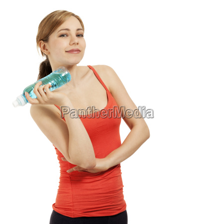 young sportswoman with a water bottle