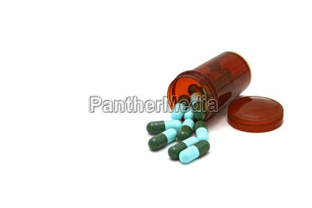 medycyna butelka z kapsulkami do lekow