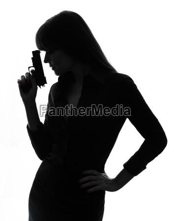 sexy kobieta detektyw majace pistolet sylwetka