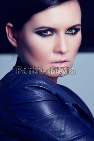 attractive beautiful confident woman with leather