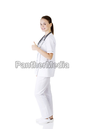young female doctor or nurse gesturing
