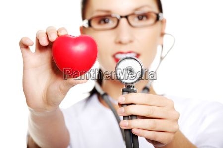 young female doctor with heart in