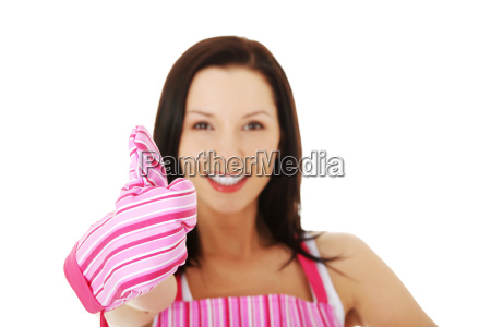 young housewife in pink apron
