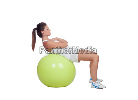 attractive girl practicing abdominal on a