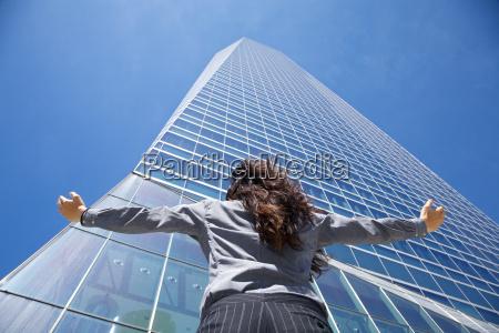 businesswoman adoring crystal skyscraper