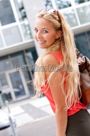 young attractive blonde woman with handbag