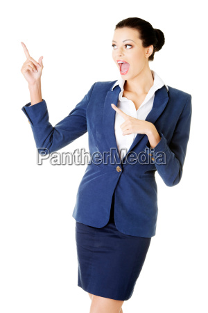 young female businesswoman pointing up