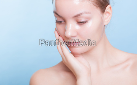 portrait blond girl in facial mask