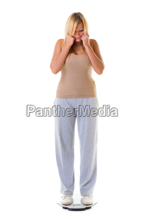 large woman on scale worried with