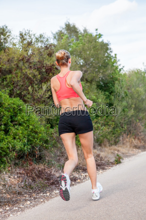 young attractive sporty woman running in