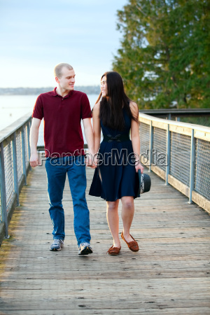 young interracial couple walking together on
