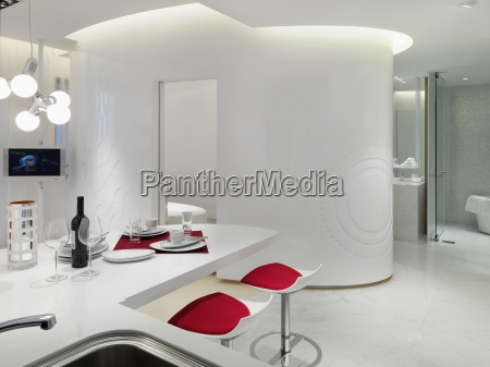 white modern interior with red accents