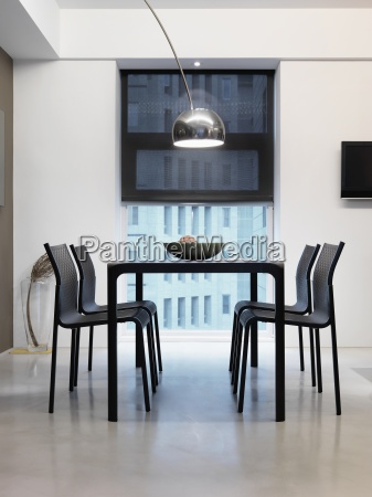 modern black dining table with overhead