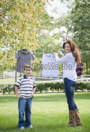 chores laundry backyard hanging drying standing