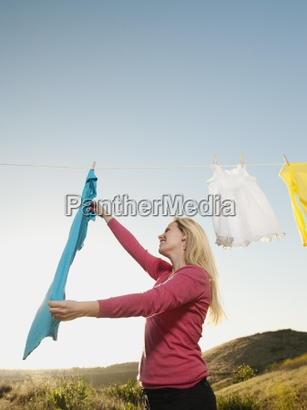 clothesline laundry woman hanging clear sky