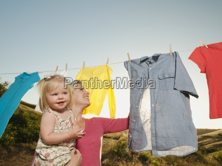 carrying mother daughter togetherness clothesline close