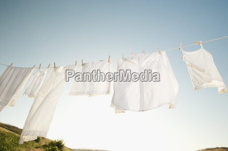 clothesline laundry hanging drying white close