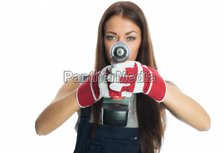 female artisan with cordless screwdriver