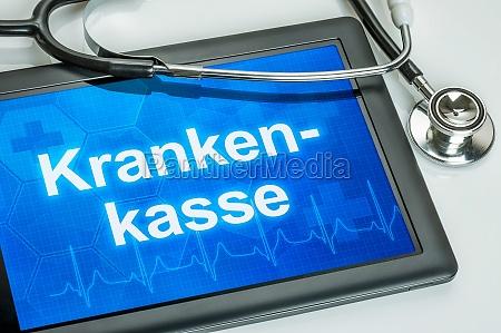 tablet z ubezpieczeniowym tekstem na wyswietlaczu