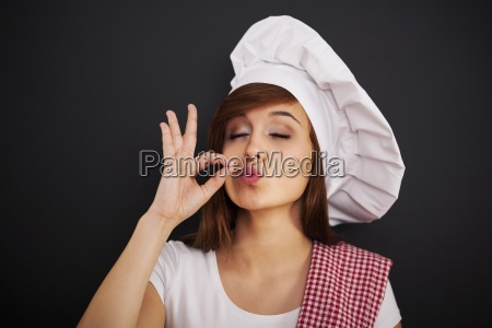 beautiful young female chef with hand