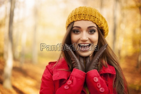 portrait of shocked woman in autumn