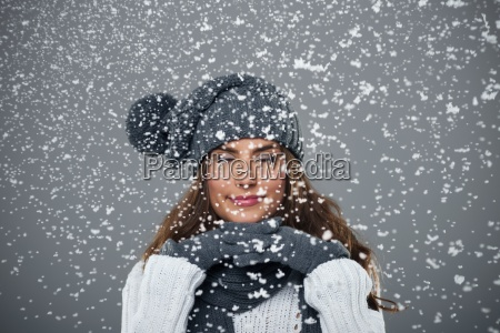 beautiful young woman enjoys first snow