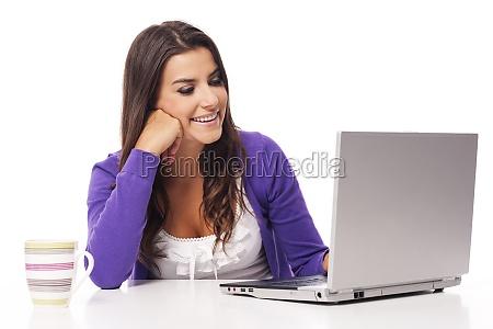 beautiful smiling woman using computer