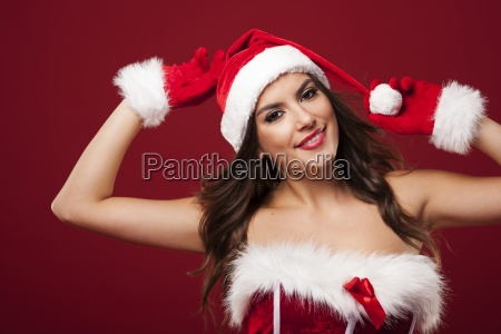 beautiful and smiling santa claus woman