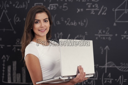 female student with laptop in her