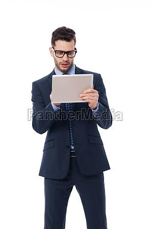 focused businessman using a digital tablet