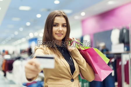 beautiful woman showing credit card in