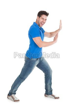 pewni man pushing billboard