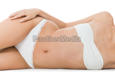 nude woman in aesthetic pose sitting