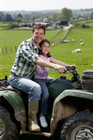 portrait of shepherd and daughter riding