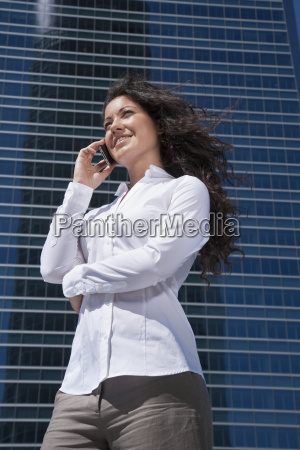 white shirt businesswoman talking mobile