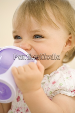 baby girl 9 12 months drinking