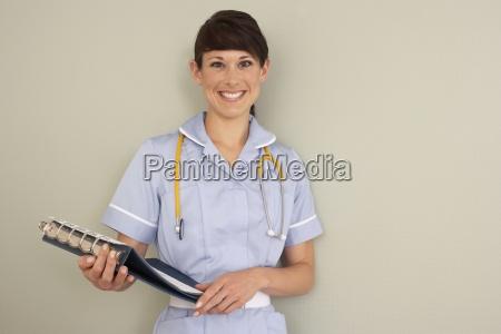 pielegniarka z stetoskop gospodarstwa plik lekarza