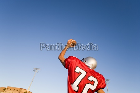 american football quarterback in red strip