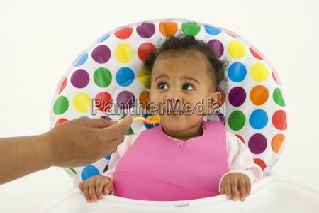mother feeding baby girl 3 6